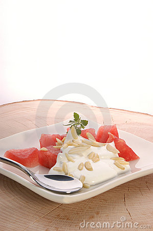 Melon with cream fresh and almond slivers