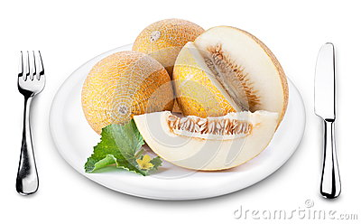 Melons with slice on a plate.