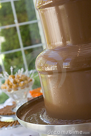 Melted chocolate fondue fountain