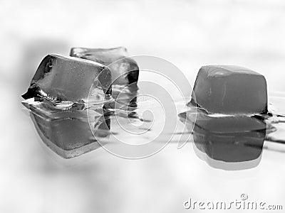 Melting ice over white