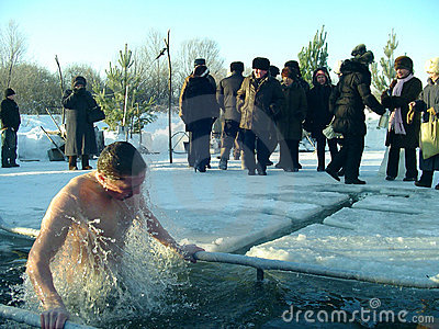 The men bathes in an ice-hole on the river Editorial Stock Photo
