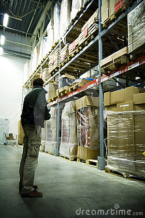 Men in big warehouse