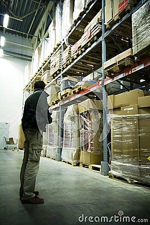 Men in big warehouse