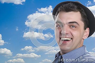 Men on black hat on blue sky