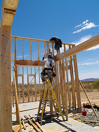 Free Men Building Frame For House - Vertical Royalty Free Stock Photography - 5975307