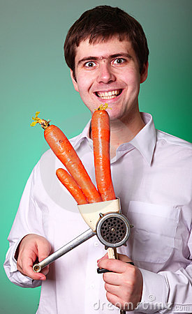 Men with chopper and carrot