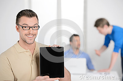 Men with digital tablet. Happy young businessman holding a digit