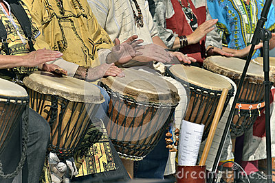 Men and famme play djembe