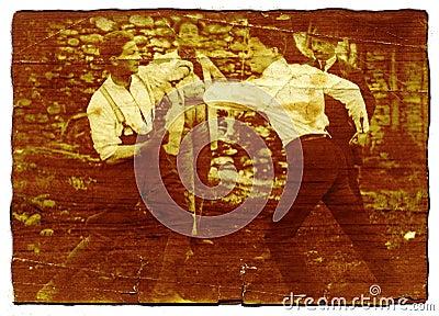 Men fighting - on wood