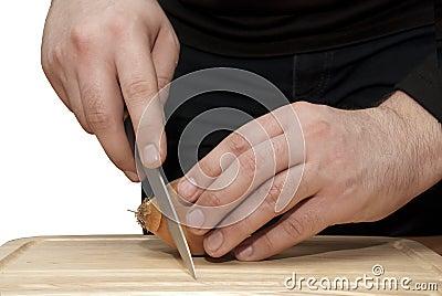 Men hands cut onion