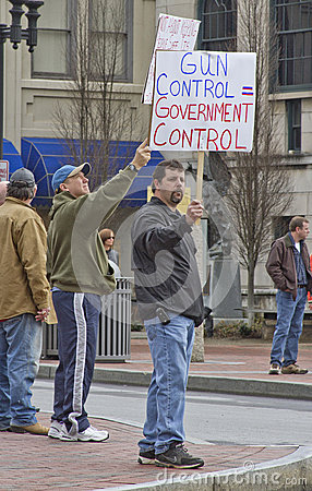 Men Holding Gun Control Protest Signs At Rally Editorial Image