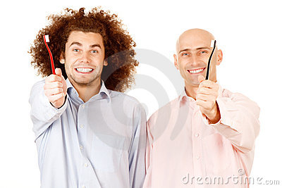 Men holding toothbrushes