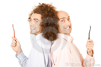 Men holding toothbrushes