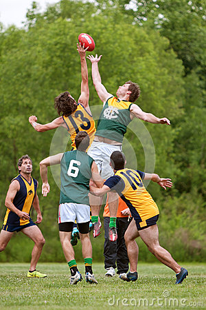 Men Jump For Ball In Amateur Australian Rules Football Game Editorial Image
