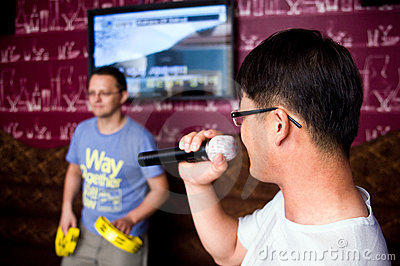 Men at karaoke club