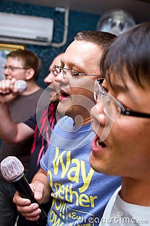 Men at karaoke club