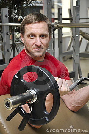 Men lifting weights