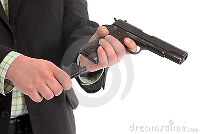 Men loading a gun
