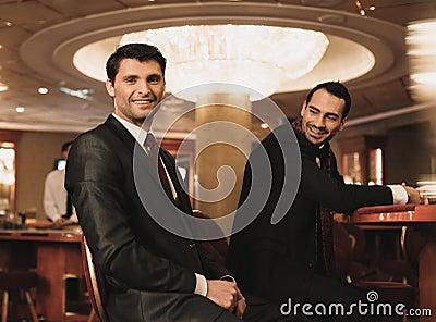 Men in luxury interior