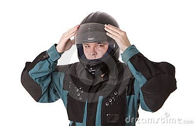 Men in motorcycle jacket founding helmet.