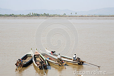 Four Small Boats in Myanmar Editorial Stock Image