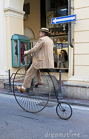 Men with old cycle,cycling through history event Editorial Stock Image