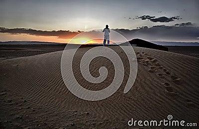 Men over dune
