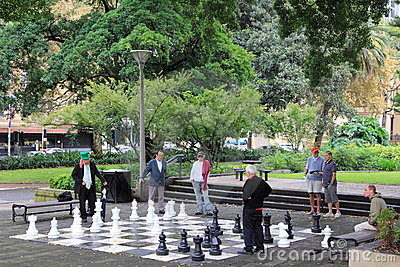 Men playing chess in park Editorial Image