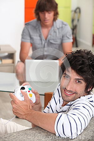 Men playing computer games