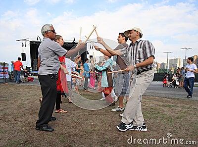 Men Playing Dandiya Editorial Image