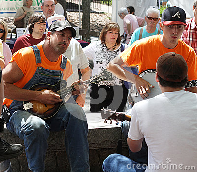 Men playing stringed instruments at festival Editorial Photography