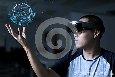 Men Playing Virtual Reality with Hololens with effects Stock Photo