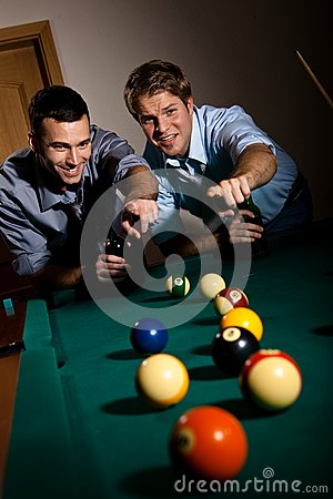 Men pointing at snooker ball