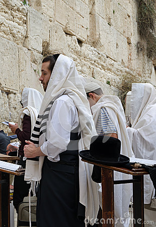 Men Praying in the Western wall Editorial Image