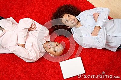 Men relaxing on rug
