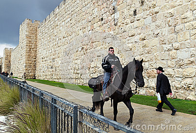 Men riding a horse in Jerusalem Old city Editorial Image