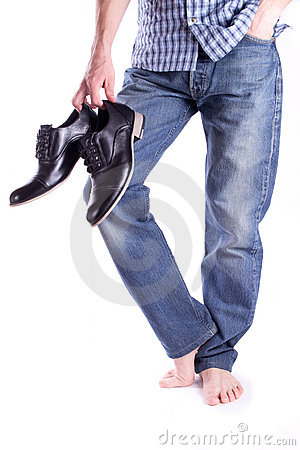 Men s barefoot and holding shoes