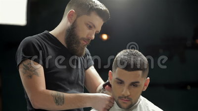 men 39 s hairstyling and haircutting in a barber shop stock footage video. Black Bedroom Furniture Sets. Home Design Ideas
