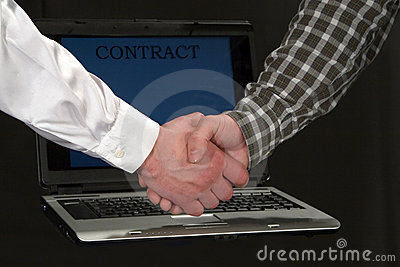 Men shaking hands in front of a laptop
