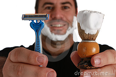 Men with shaving brush and razor