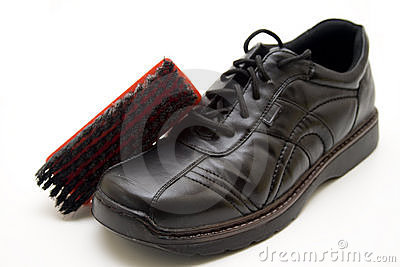 Men shoe with shoe brush