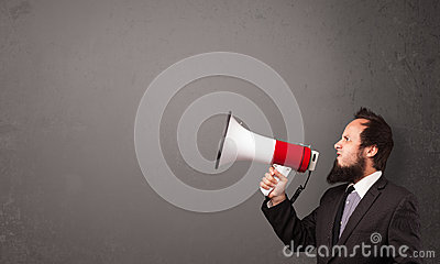 Men shouting into megaphone on copy space background