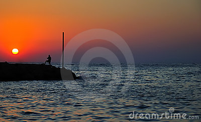 Men silhouette on the sea background