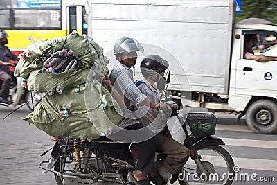 Men transport huge load Editorial Image