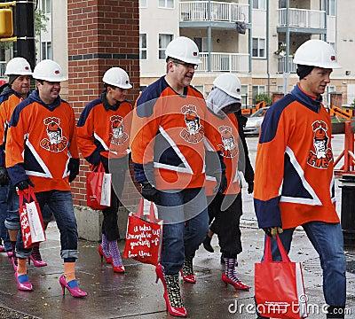 Free Men Walking In Womens High Heels Stock Photography - 145810032
