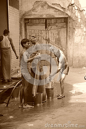 Men washing clothes Sepia. Old Delhi, India.