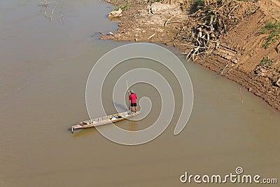 Men wear red fishing boat.
