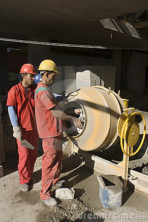 Men Work with Cement Mixer - Vertical