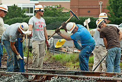 Men Working on Railroad Track Editorial Photo