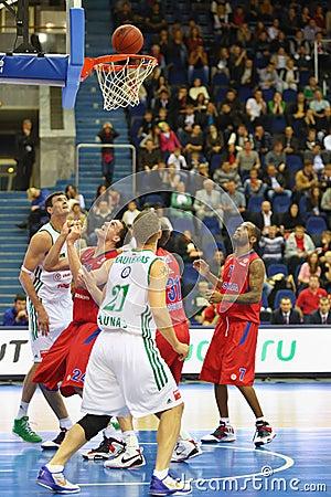 Men from Zalgiris and CSKA Moscow teams play basketball Editorial Stock Photo